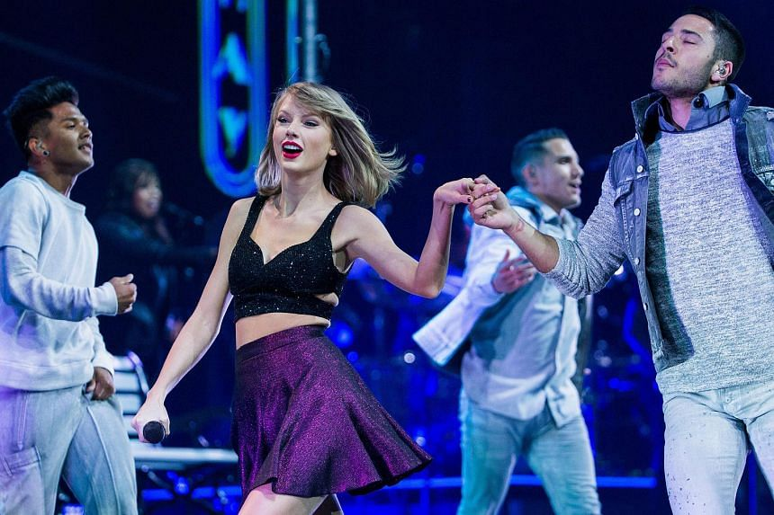Apple has reversed its decision not to pay artists during the three-month free trial period of its new streaming service Apple Music, after criticism from singer Taylor Swift (left).