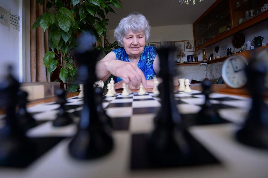 87-year-old Hungarian chess master, Brigitta Sinka, presents a game in her home on May 7, 2015 in Budapest.