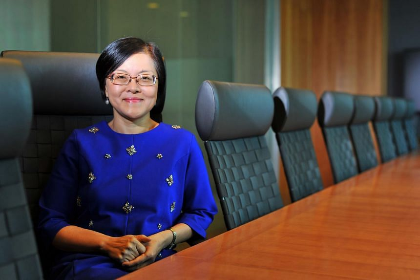 """Ms Kuan Li Li says being the head of a bank today is not just about being a rainmaker and bringing in the bread. """"It's actually about being able to manage and harness the whole operating ecosystem."""" -- PHOTO: LIM YAOHUI FOR THE STRAITS TIMES"""