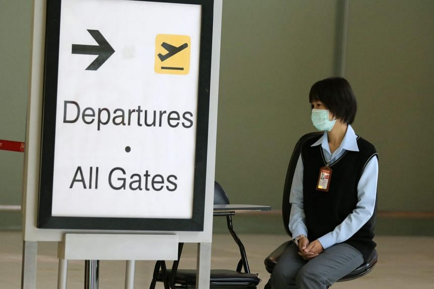 A member of the airport staff wears a protective mask against Middle East Respiratory Syndrome (Mers) while on duty at Suvarnabhumi airport in Bangkok, Thailand.