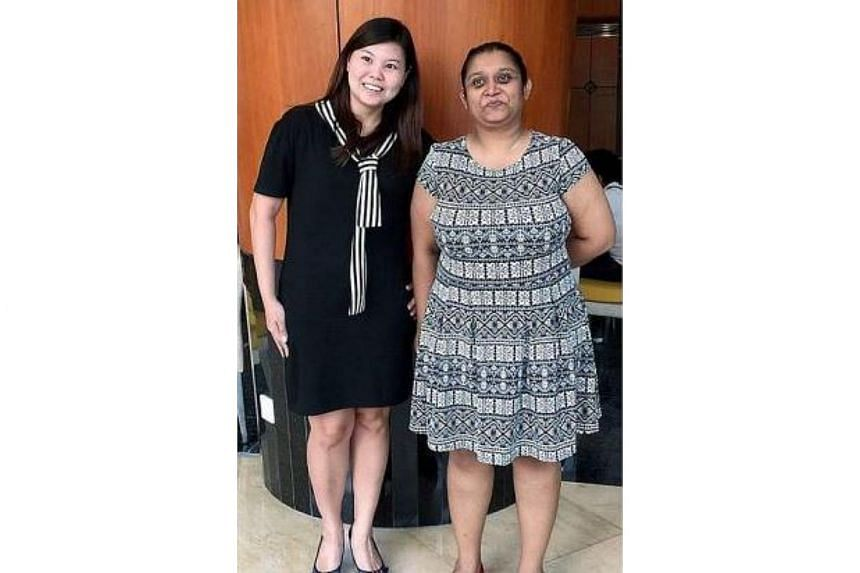 Journalist C. Premanthini (right) together with the Klang resident at the Selangor State Secretariat building. The two women were told to wear a sarong to enter the building.