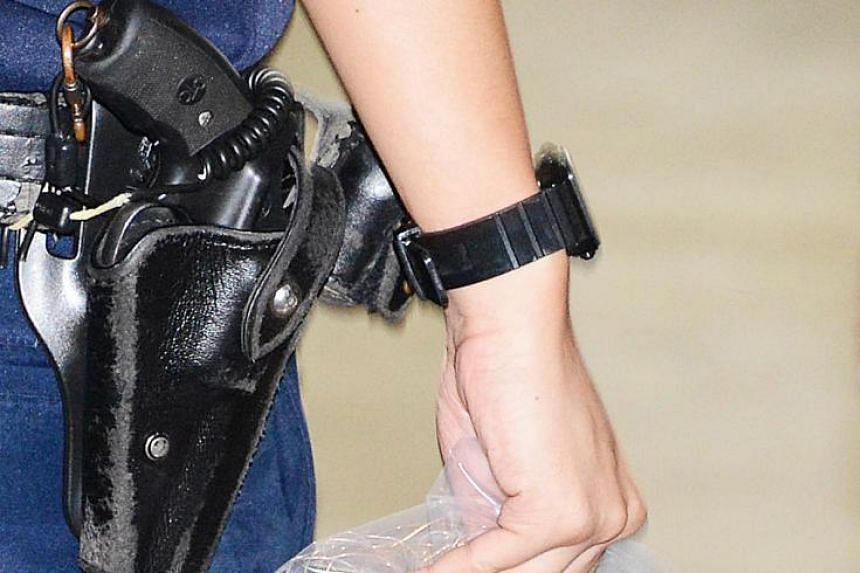 A police officer's holstered revolver.