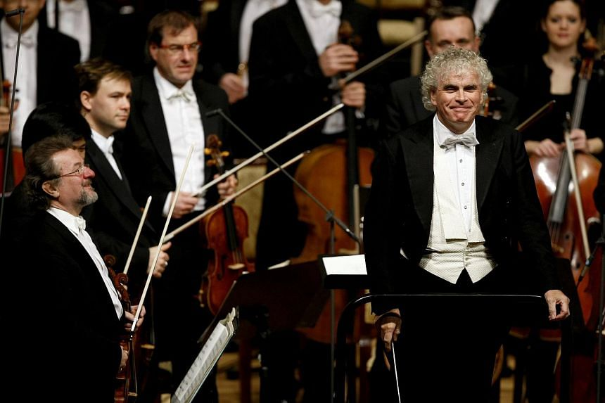 Sir Simon Rattle performing with members of the Berlin Philharmonic Orchestra during a concert in Abu Dhabi on Nov 9, 2010.