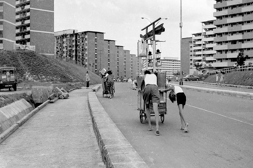 "On Our Way To Pasar Malam (1968, above), digital print on archival paper: Loke favours this shot of street vendors pushing their carts along Circuit Road near Aljunied, as it is ""layered"". He explains: ""In the foreground, you have the hawkers. By the"