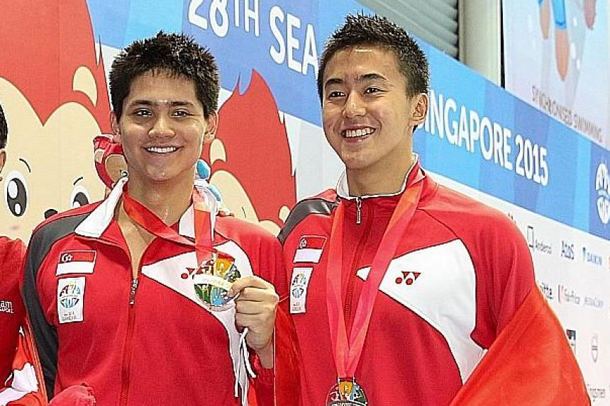 Swimmer Joseph Schooling (left) was due for enlistment this year, but was granted deferment until August next year. Plans are also afoot to facilitate swimmer Quah Zheng Wen's application for deferment.