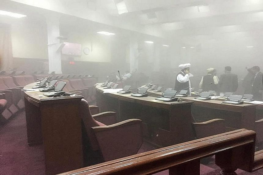 Lawmakers inside a smoke-filled Parliament after the attack, in a handout picture from Afghan MP Najibullah Faiq. Kabul police chief Abdul Rahman Rahimi said all lawmakers were safe.