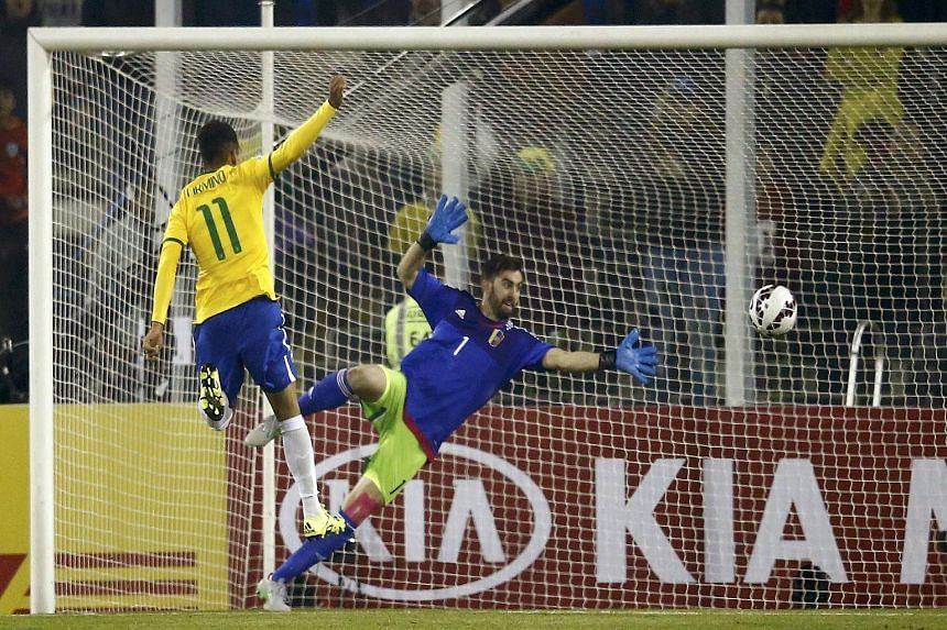 Brazil's Roberto Firmino scores past Venezuela goalkeeper Alain Baroja in their 2-1 Copa America win, ensuring that the South American giants qualify for the quarter-finals as Group C winners.