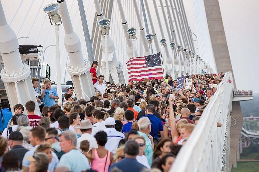 Thousands of people gathering across the Arthur Ravenel Bridge to forge what organisers called a Bridge to Peace Unity Chain nearly 4km long.