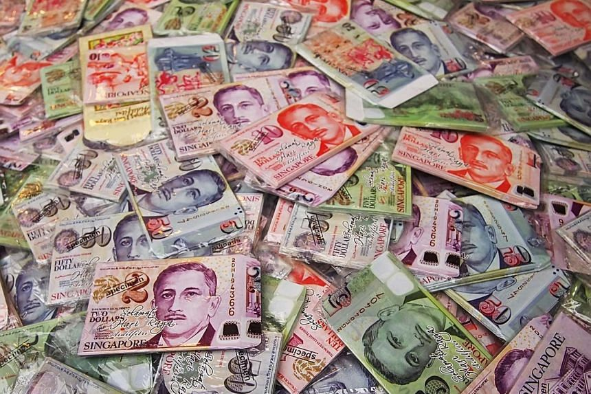 Money packets in the form of Singapore currencies, being sold at a Ramadan bazaar in Geylang Serai on Aug 16, 2012. PHOTO: BERITA HARIAN