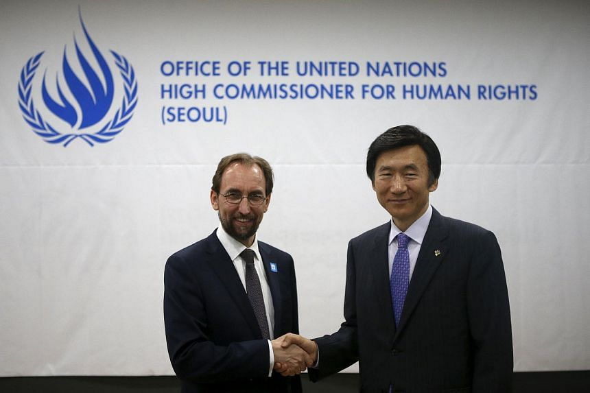 United Nations High Commissioner for Human Rights Zeid Ra'ad Al Hussein (left) shakes hands with South Korean Foreign Minister Yun Byung Se during the opening ceremony for the Seoul Office of the United Nations High Commissioner for Human Rights on J