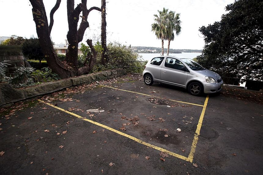 A car space (front) that was sold at auction earlier this month for A$120,000 (S$123,900), can be seen in the inner-Sydney suburb of Kirribilli, Australia June 23, 2015.