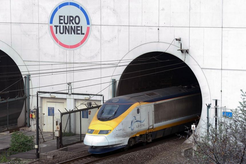 A file photo taken on April 10, 2014, shows a Eurostar passenger train exiting the Channel Tunnel, operated by EuroTunnel, in Coquelles, northern France.