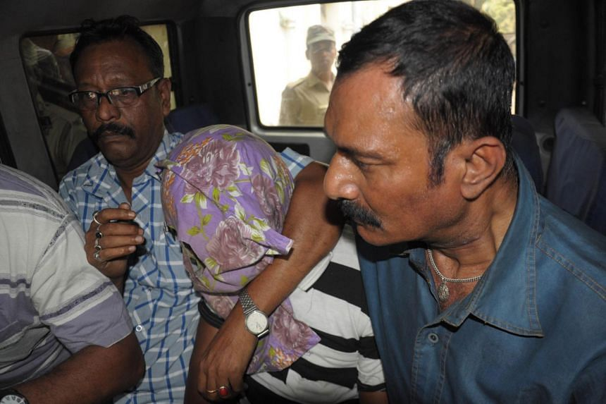 Indian police escort suspect Gopal Sarkar (centre) in Ranaghat on March 27, 2015, after he was arrested in connection with the rape of a nun in West Bengal.