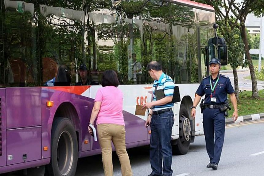 The off-service SBS Transit bus being inspected after it collided with Ms Lucinia Wong Hang Yee, a nurse, outside Punggol bus interchange on May 15, 2015.