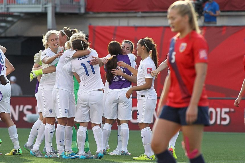 England's players celebrate a victory over Norway during the Fifa Women's World Cup 2015 round of 16 match.