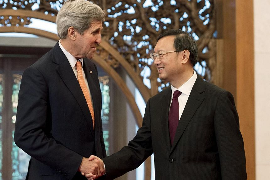 US Secretary of State John Kerry (left) and Chinese State Councilor Yang Jiechi at Diaoyutai State Guesthouse in Beijing on May 16, 2015.