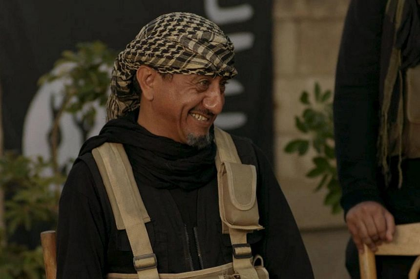 """Saudi actor Nasser al-Qasabi smiles as he plays the role of an Islamic State fighter in the new Saudi TV show """"Selfie""""."""