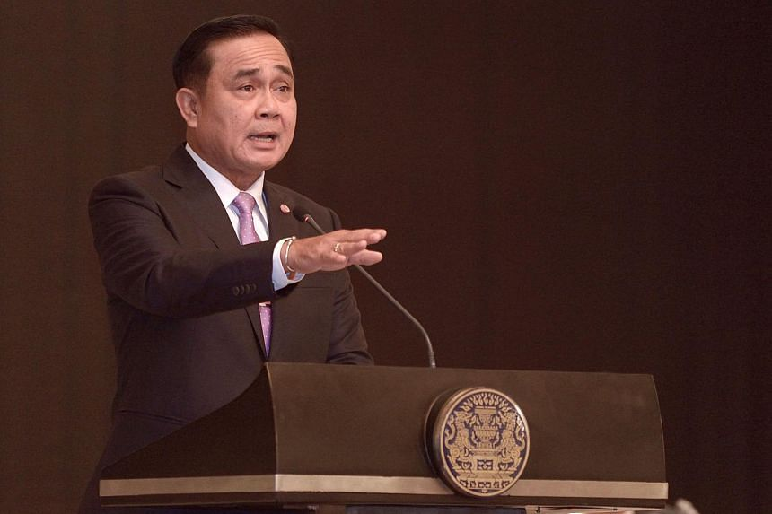 Thai Prime Minister Prayut Chan-o-cha gestures as he speaks during a press conference at Government House in Bangkok on April 17, 2015.