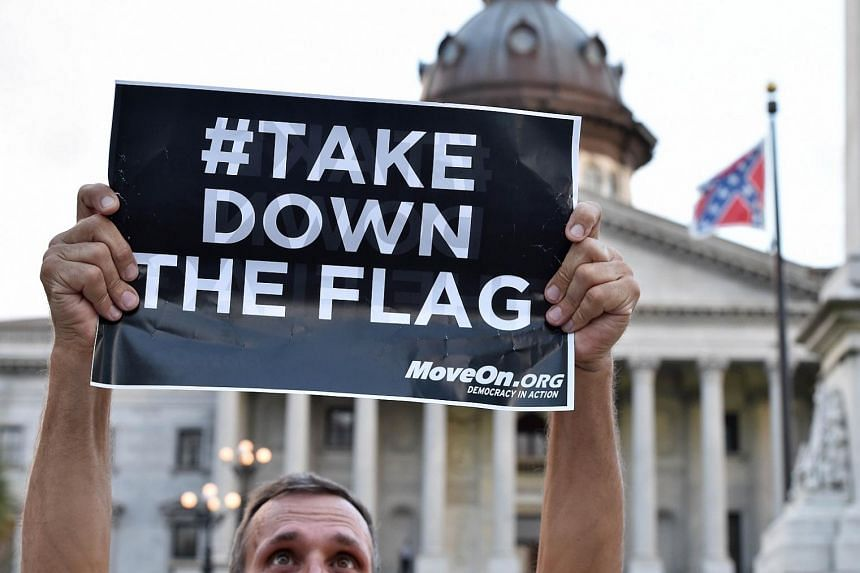 Hundreds of people gather for a protest rally against the Confederate flag in Columbia, South Carolina on Saturday (June 20). The racially divisive Confederate battle flag flew at full-mast despite others flying at half-staff in South Carolina after