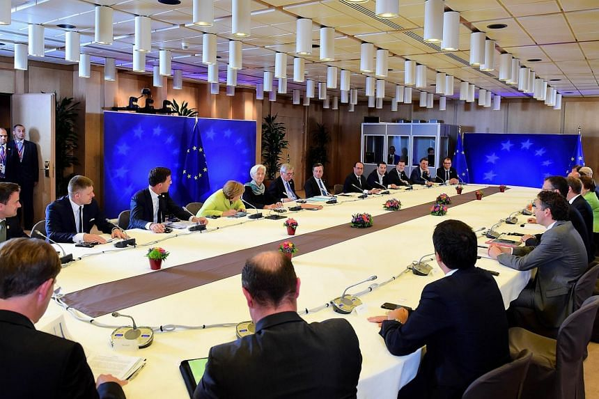 European leaders meet during an emergency leaders summit on Greece at the European Council in Brussels on Monday. Greece's international lenders raised hopes for a vital bailout agreement this week to save Athens from default and a possible euro exit