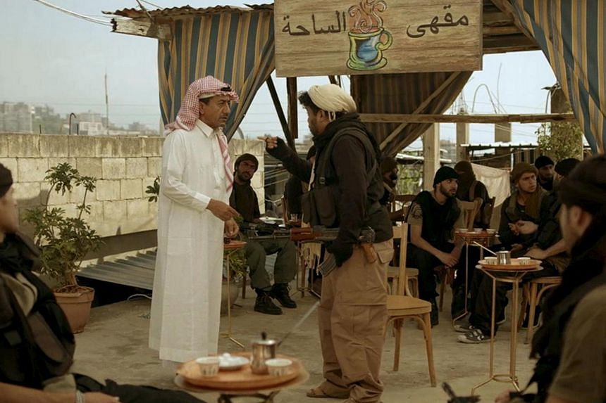 """Saudi actor Nasser al-Qasabi (in white) plays the role of an Islamic State fighter in the new Saudi TV show """"Selfie"""", a sketch comedy show which debuted last week on Saudi-owned pan-Arab satellite channel MBC, in this undated handout photo provided b"""