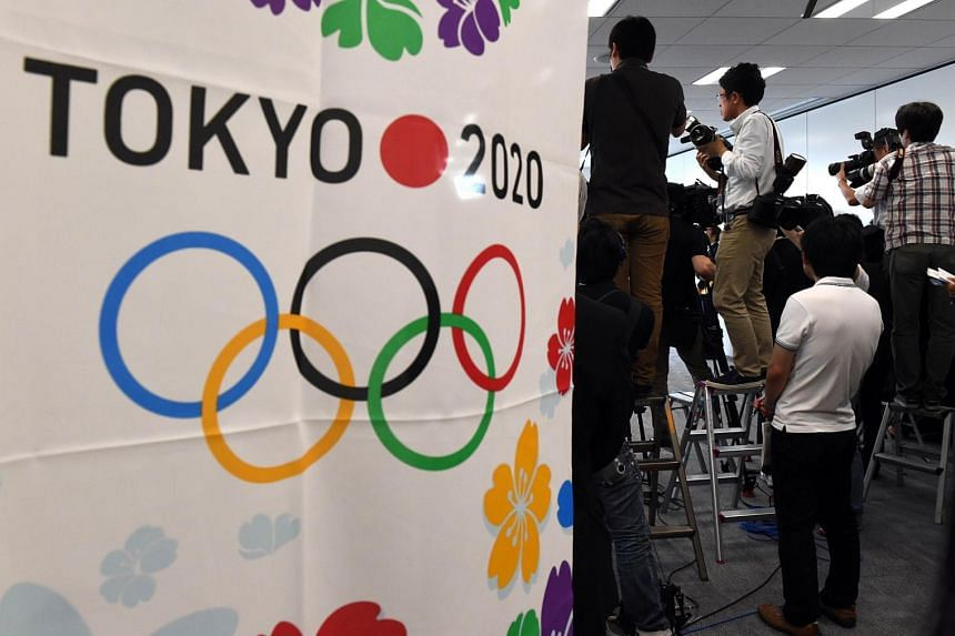 Photographers take pictures during the meeting of the Tokyo 2020 additional event programme panel at the Tokyo 2020 organising committee headquarters in Tokyo on Monday. The organisers nominated eight new sports for possible inclusion in the Tokyo Ga