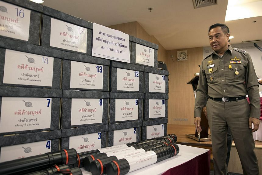 Thai national police chief Somyot Poompanmuang stands next to boxes of documents during a news conference on the recent human trafficking case at the Anti-trafficking in Persons Division in Bangkok, Thailand, on June 23, 2015.