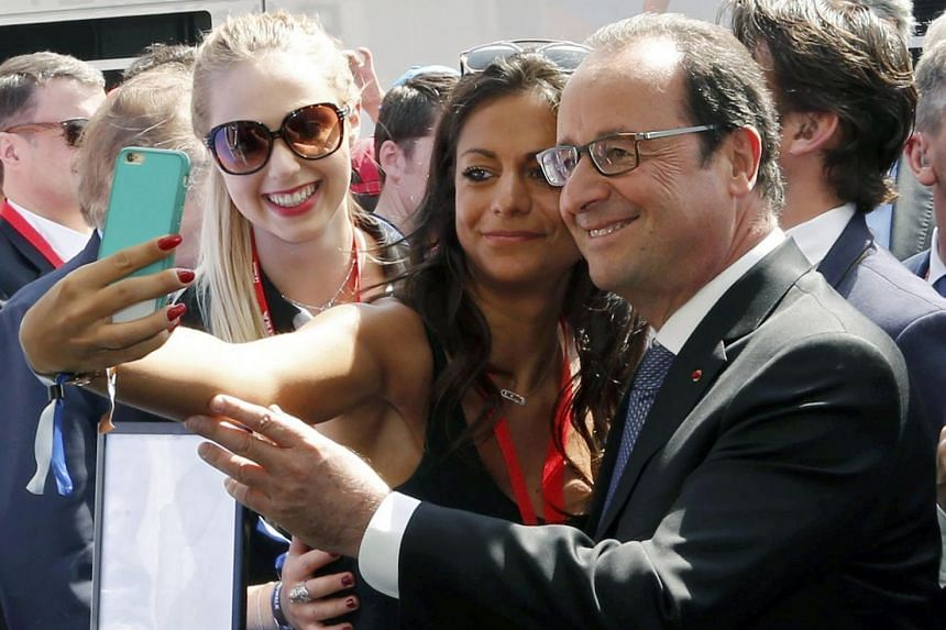 French President Francois Hollande has been criss-crossing the country and pressing the flesh, including at Le Mans this month where he posed for a selfie with a spectator (above).
