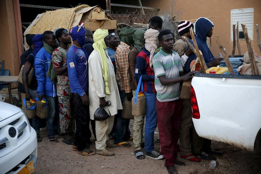 Migrants waiting to board a truck in the desert town of Agadez, Niger, last month. A record 100,000 migrants areexpected to cross Niger this year into Libya, from where they hope to make the dangerous sea crossing to Europe. Hundreds of migrants have