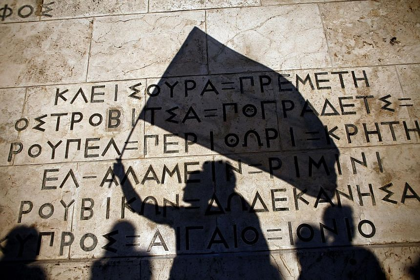 """Protesters' shadows on a monument for the unknown soldier at a pro-European Union demonstration in Athens on Monday. The latest plan offered by the Greek government has been characterised as """"broad and comprehensive""""."""