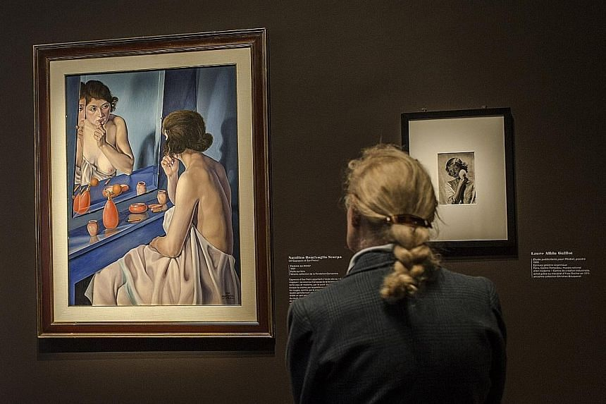 The display of more than 100 works at the Musee Marmottan Monet in Paris includes Natalino Bentivoglio Scarpa's Woman At The Mirror (left) and Study For Phebel Powder Advertisement (right) by Laure Albin Guillot.