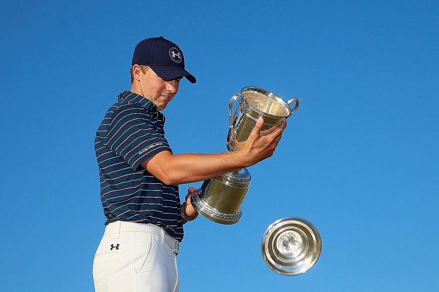 (Above) Rory McIlroy had shots to rue at the US Open and his 66 on the final day could not make up for his slow start. (Left) Jordan Spieth can afford a smile as the top of the US Open trophy falls off since he has won two Majors at just age 21.
