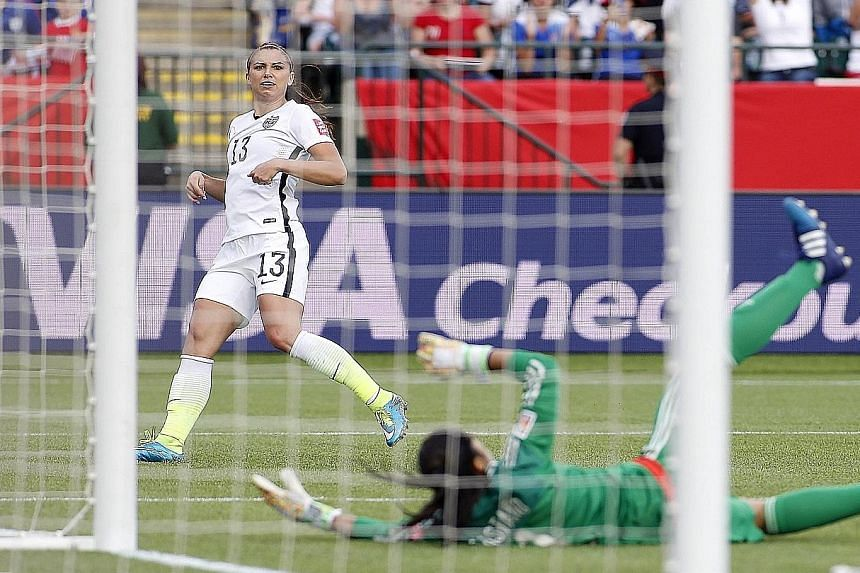 Striker Alex Morgan scores to set the United States on their way to a 2-0 last-16 victory over Colombia in the Women's World Cup. The US will meet China in the last eight, a repeat of the 1999 final.