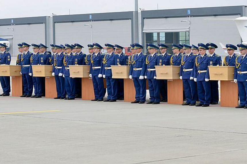 The remains of MH17 victims are transferred from Ukraine on May 2, 2015.