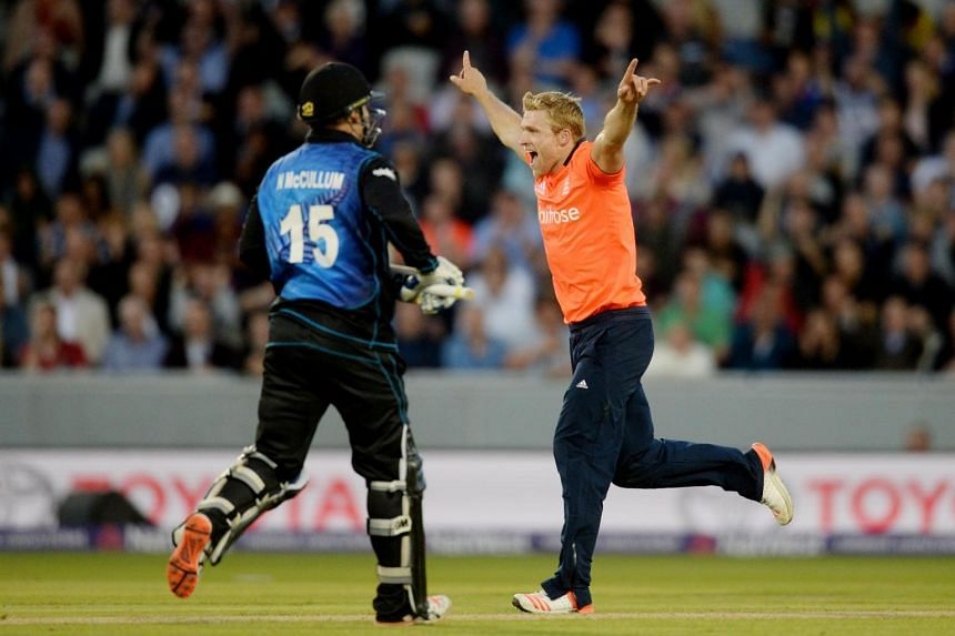 England's David Willey (right) celebrating after dismissing New Zealand batsman Nathan McCullum.