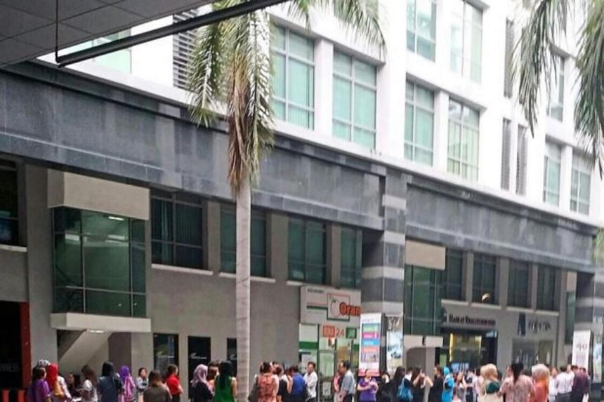 Employees gathering outside the KK Times Square building  after the evening tremors in Kota Kinabalu.