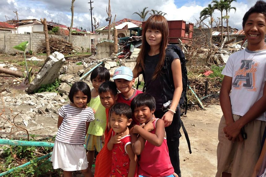 ST correspondent Joyce Lim with young survivors of the devastating typhoon that struck the Philippines in 2013.