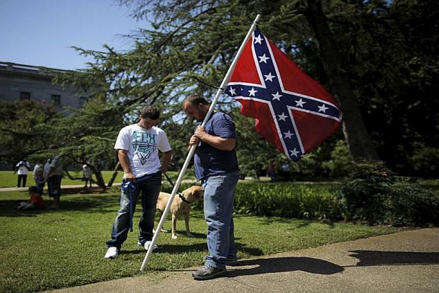 A man holding the Confederate flag at a South Carolina rally.