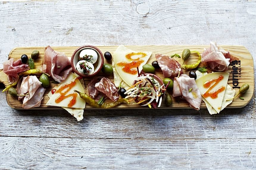 Jamie Italian's plank piled high with cured meats, pickles and tempting cheeses.