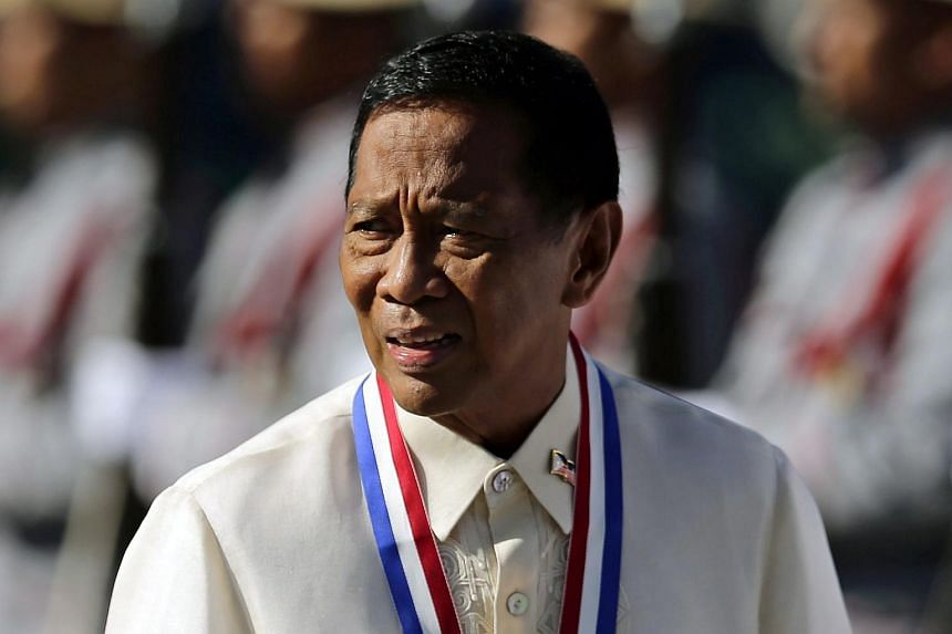 Philippine Vice-President Jejomar Binay reviews honor guards during Independence Day rites at Luneta Park in Manila, Philippines, 12 June 2015.
