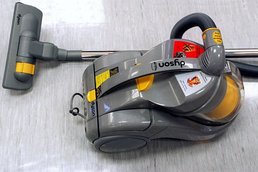 A German shop assistant in a late-night convenience store chased away two armed robbers with the hose of a vacuum cleaner she had been using, said German police.
