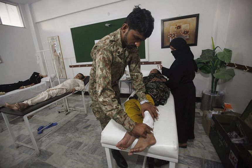 A woman suffering from the heatwave receiving treatment at an army heat stroke relief centre, which was set up at a local school in Karachi, Pakistan, on June 23, 2015.