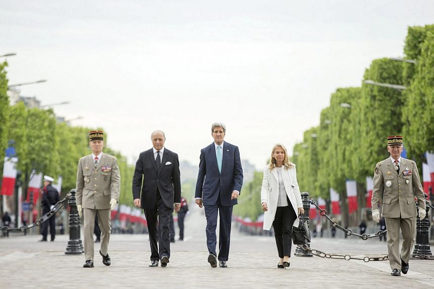 US Secretary of State John Kerry (centre), accompanied by French Foreign Minister Laurent Fabius (2nd left) and US Ambassador to France Jane Hartley (2nd right), participates in a wreath-laying ceremony marking France's 70th anniversary of the allied