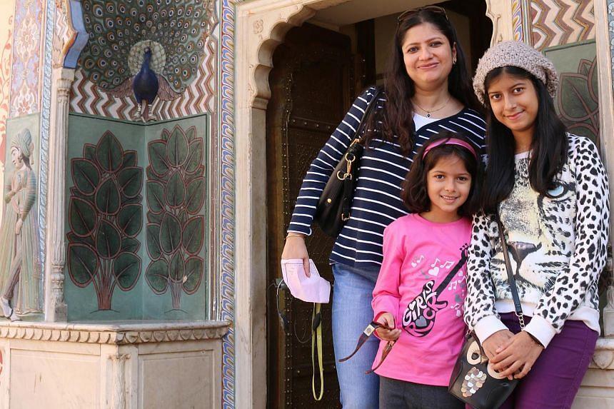 ST Senior Correspondent Radha Basu with her daughters Maya, seven, and Rhea, 16.