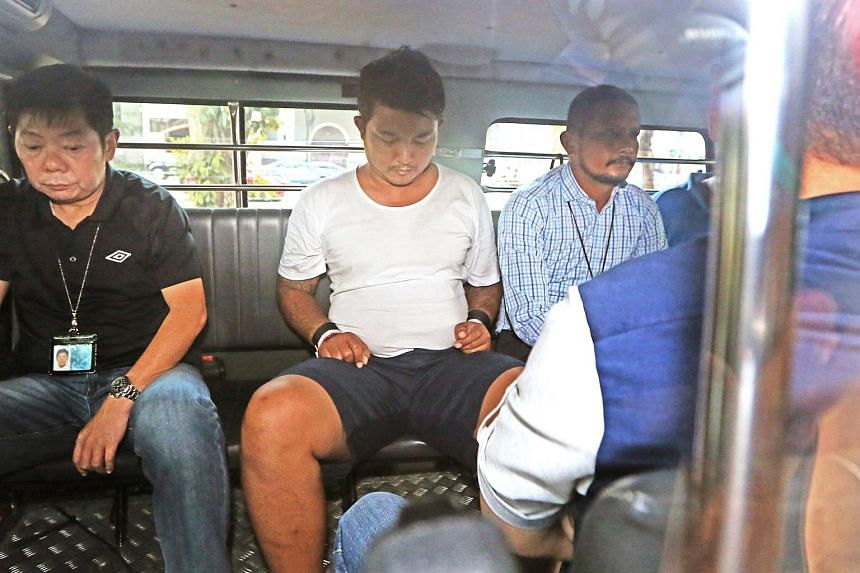 Phyo Min Naing, 31, (in white T-shirt) being taken to court.