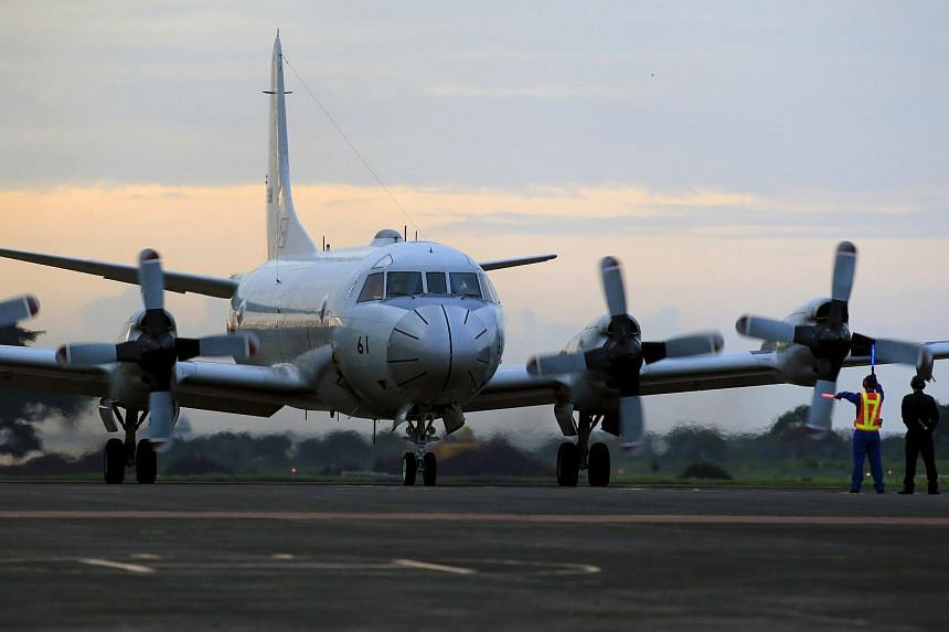 A Japanese P3-C Orion plane taxis before taking off at an airport runway in Puerto Princesa, Palawan, west Philippines on June 23, 2015.