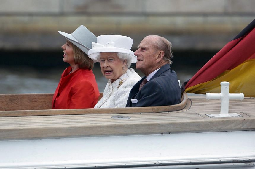 Britain's Queen Elizabeth II (centre), her husband Prince Philip (right) and German President Joachim Gauck's partner Daniela Schadt (left) take a boat trip along the Spree river in Berlin, Germany, June 24, 2015.