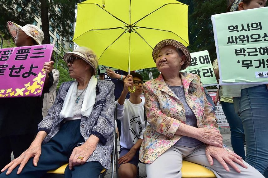 South Koreans Kim Bok Dong (left) and Gil Won Ok (right) were forced to serve as sex slaves for Japanese troops during World War II. They told a press conference outside the Japanese embassy in Seoul yesterday that they want an official and sincere a
