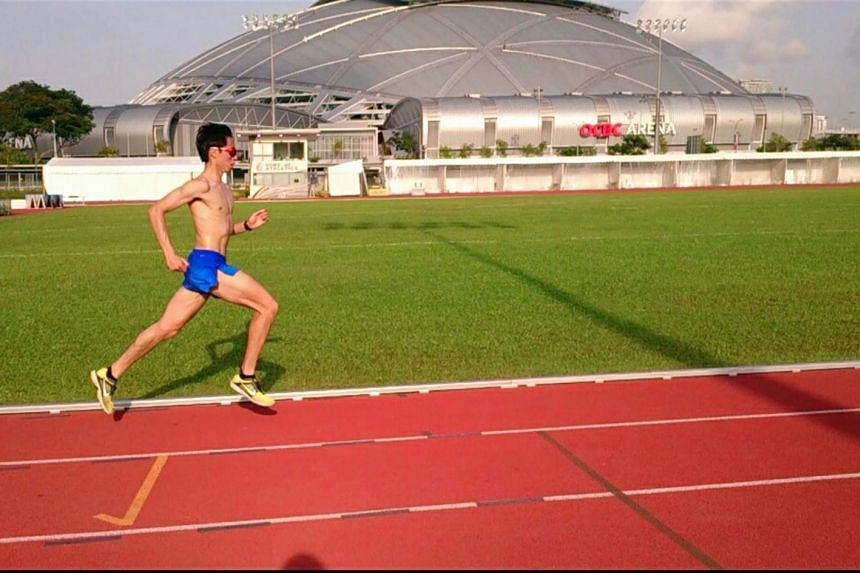 Preparing for the SEA Games with a track workout (above) in the scorching morning sun.