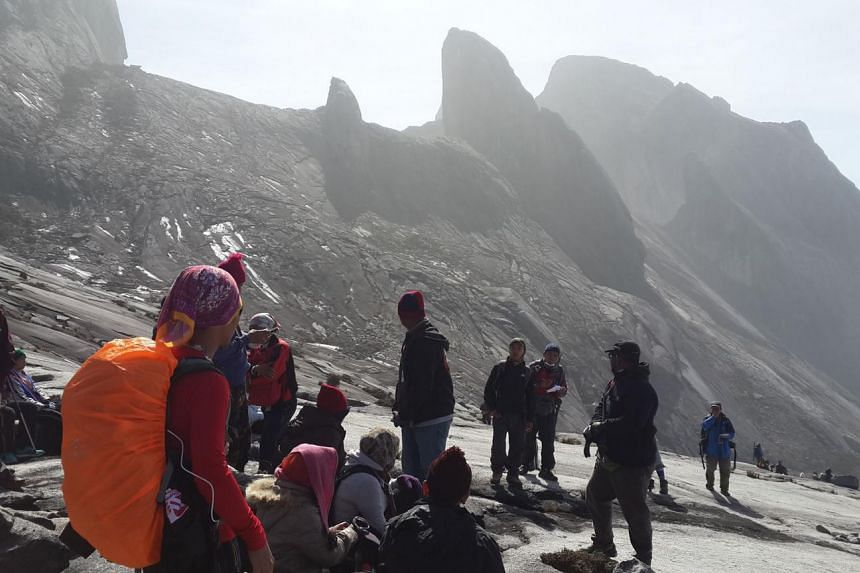 Stranded climbers on Mount Kinabalu after the quake struck earlier this month. The newly launched Mountain Search and Rescue unit is based at Ranau fire station and has 20 auxiliary firemen for a start, all of whom are mountain guides. Their training